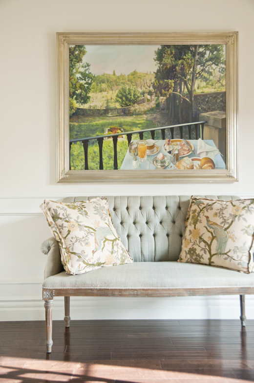 A dining room was given a whole new look by adding simple little touches like this sofa and this painting. Click here to read how we did it  #reupholstery #vintage #interiordesign | D.L. Rhein