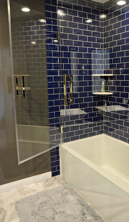 Blue tile and taupe walls - just what this teenager needed to update his bathroom. Read our post to see how we did it. #tile #makeover #bathroom | @D.L. Rhein