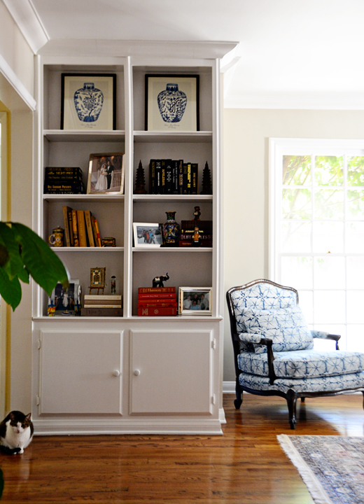 A well edited selection of books mixed with some vintage treasures and family heirlooms make these shelves a work of art.  #heirlooms #treasures #shelfdecor #juging #makeover #livingroom #dlrhein   @D.L. Rhein