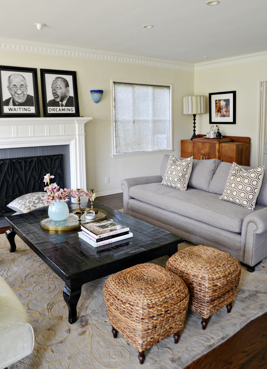 A striped ottoman is replaced with a vintage coffee table stained in ebony #makeover #livingroom #ebonytable #art |@D.L. Rhein