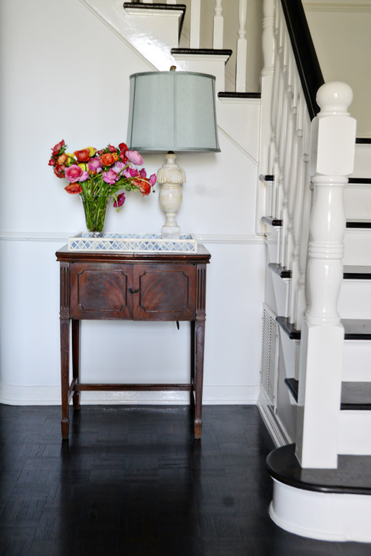 A vintage marble lamp and fresh flowers add a punch to a neutral area when set atop a stunning tray | D.L. Rhein