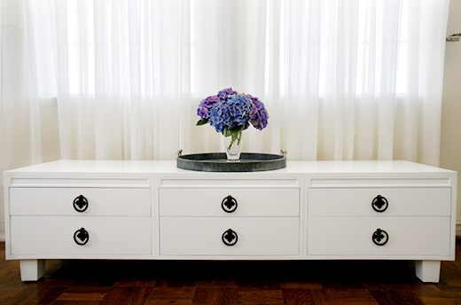 AFTER | Vintage Dresser Lacquered in White, bronze hardware, feet instead of wheels | #dlrhein
